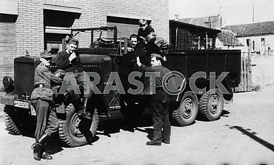 German soldiers and kids with truck.