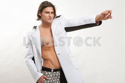 Fashion shot of a Young Man a trendy european man dressed in con