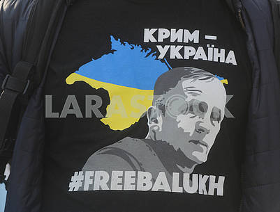 Portrait of Vladimir Balukh on the T-shirt of the participant of the action