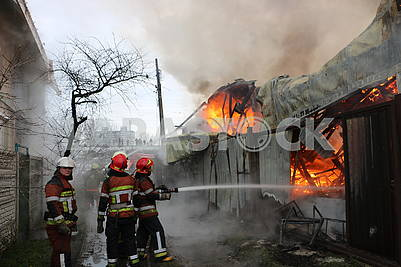 Firefighters extinguish the house