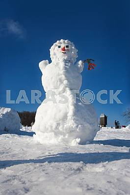 Big snowman on sky background