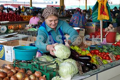"A woman sells vegetables at the market ""Privoz"" September 9, 2011"