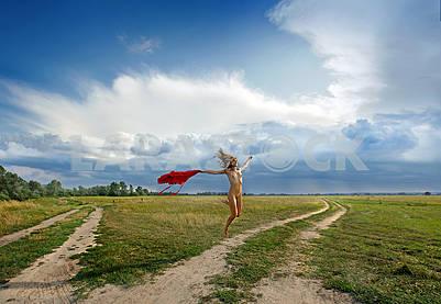 naked girl jumping against the sky