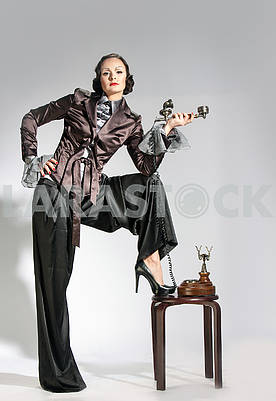 Woman talking on the retro phone