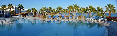 Swimming pool with sun beds at the hotel