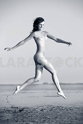 Woman with perfect body jumping