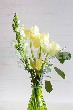 Orchid,tulip,hyacinth flower composition in glass vases.