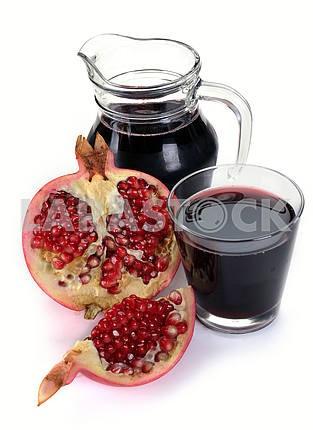 Jug of juice and ripe piece grenade