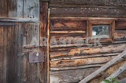 Cow barn wall with small window