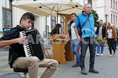 The young man plays the accordion in Lublin