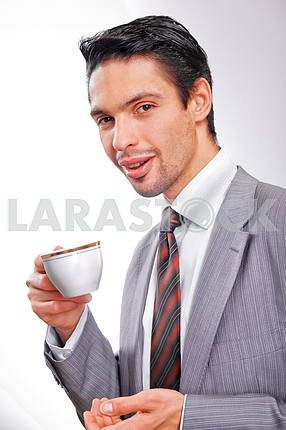Businessman drinking coffee with a cup