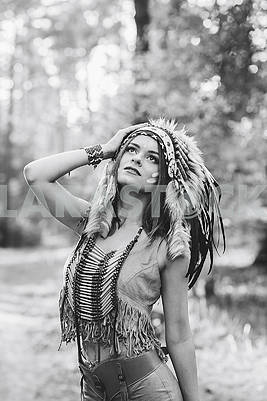 Young woman dressed in an Indian style in the woods attractive indian woman portrait outdoors. Background with free text space