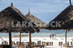 Tourists on the beach of the Indian Ocean. Zanzibar.