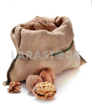 Walnuts and a bag on white