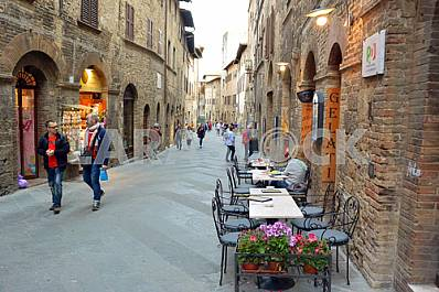 Passers-by on the street in San Gimignano