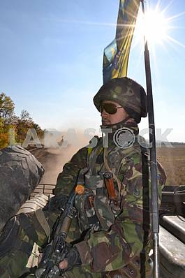 Ukrainian soldier on an armored personnel carrier