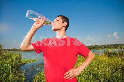 young people drink water from a bottle