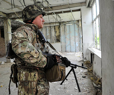 Soldier in a ruined building