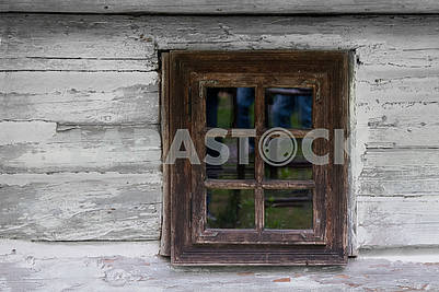 Vintage wooden  window of old wooden house. Background of wooden