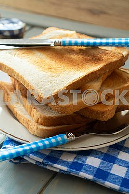 slices of rye dry bread as toast for breakfast with vintage knife