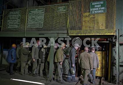 Miners near the cage at the mine. Melnikov