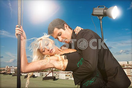 attractive young couple embraced on a background of blue sky