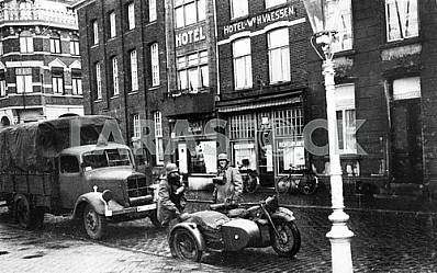 The soldiers of the Wehrmacht and the German military equipment BMW R-72, and Mercedes-Benz 3500