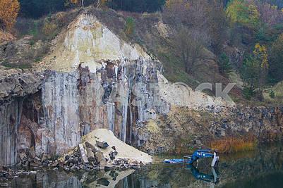 Excavator in basalt quarry