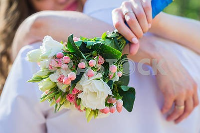 Wedding bouquet in the hands of a  bride - made from roses