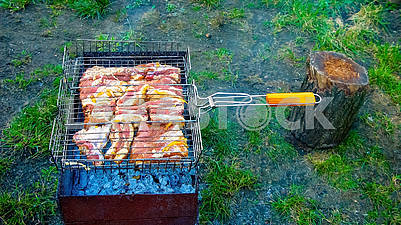 The process of cooking meat on the grill