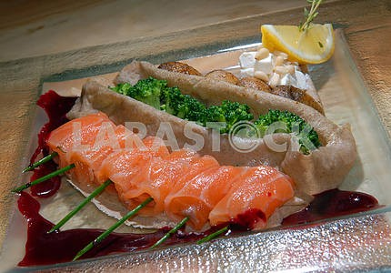 Fillet of red fish with vegetables