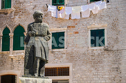 Stone statue and linen