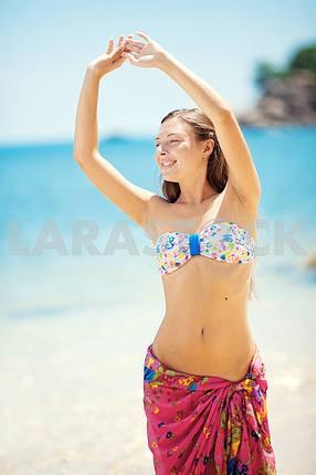 Beautiful young girl on beach