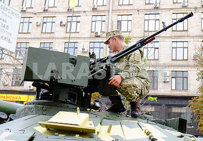 Serviceman on the turret of the tank