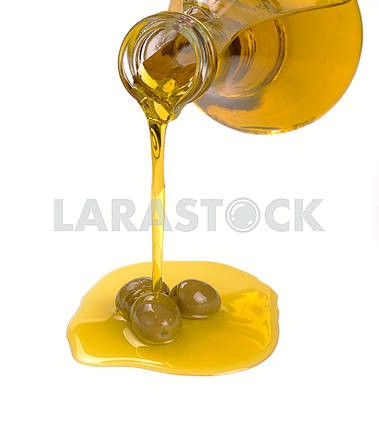 Olive oil pouring from a bottle