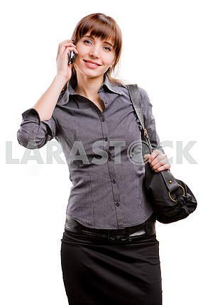 young smiling successful business woman speaks by a mobile phone