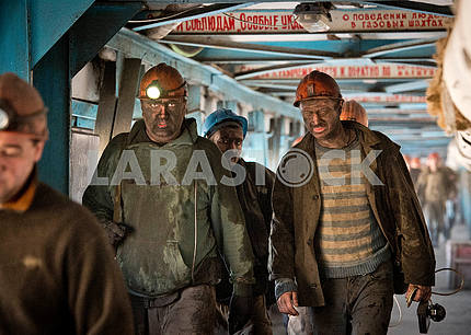 Miners come out of the face
