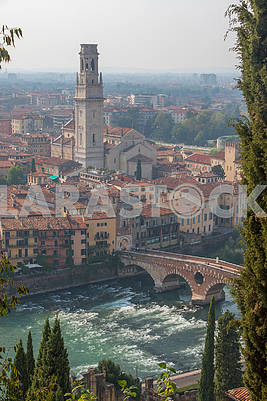 Bridge Ponte Pietra and the bell tower of Verona