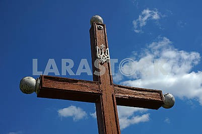 Wooden cross with a trident