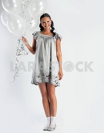 Smiling girl with white balloons