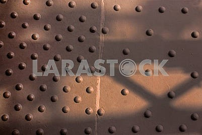 Close-up big convex rivets