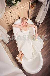 Blonde Bride in bathroom lying, smile, looking up, women