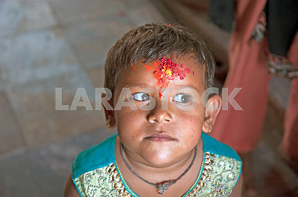 Nepalsky boy with ritual applied tilak
