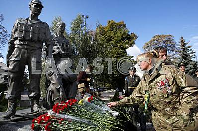 People laid flowers at the memorial to the soldiers of Ukraine, who died in Afghanistan