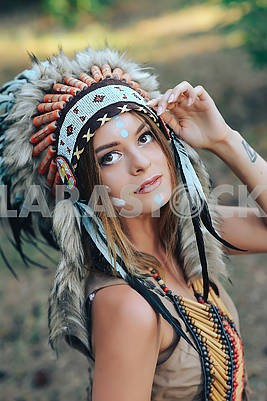 indian woman portrait outdoors. Native American, Indian woman with traditional make up and headdress Portrait of a young lady in the Indian roach
