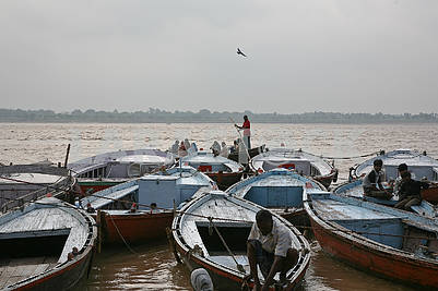 Boats near the shore of the sacred river Ganges.
