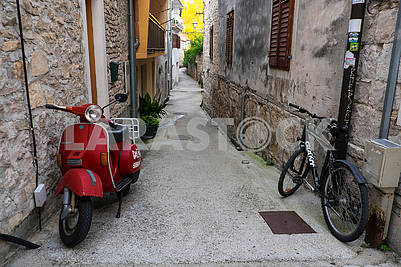 Scooter and bike on a narrow street in Skradin