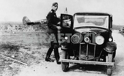 German soldier near Morris-8 car.