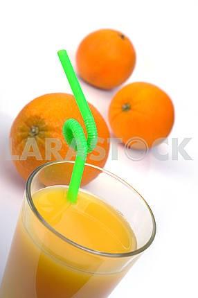 Glass of fresh orange juice and fruits