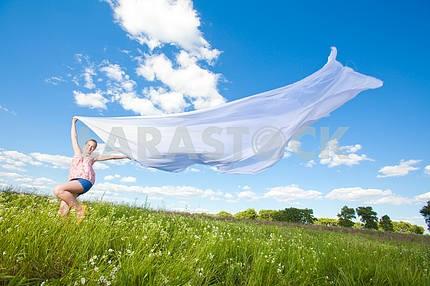 Pretty girl having fun flying in blue sky